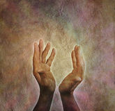 The Ancient Art of Healing. Male hands outstretched with parchment aged paper background Royalty Free Stock Photo