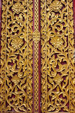 Ancient art pattern on the wooden door in Thai temple Royalty Free Stock Photos
