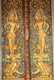 Ancient art pattern on the wooden door in Thai temple Royalty Free Stock Image