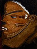 Ancient. Artifact or mask with black background side Stock Photography