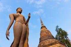 Ancient,Asia Travel. Sukhothai Historical Park. Buddhist sculpture. Buddha statue walking. Sukhothai Historical Park, Travel Asia Royalty Free Stock Image