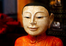 Ancient Asian Statue. An ancient colorful oriental statuette Royalty Free Stock Photography