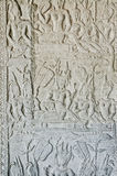 Ancient asian stone carved figures in angkor wat temple cambodia Stock Photo
