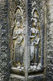 Ancient asian stone carved figures in angkor wat temple cambodia Royalty Free Stock Images