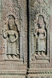 Ancient asian stone carved figures in angkor wat temple cambodia Royalty Free Stock Photo