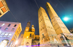 Ancient Asinelli Towers at night with church in Bologna, Italy Royalty Free Stock Photos