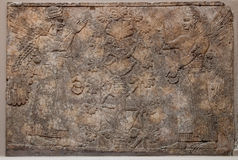 Ancient assyrian relief depicting winged gods or s Stock Images