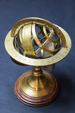 Ancient astrolabe. A view of a golden ancient astrolabe royalty free stock photos