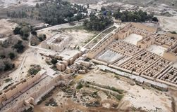 Ancient Babylon in Iraq from air. Restored ruins of the South palace of Nebuchadnezzar in ancient Babylon, Iraq on the right. Ruins of the North palace damaged stock photo
