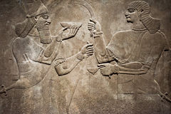 Ancient Babylonia and Assyria bas relief. Ancient Babylonia and Assyria sculpture painting from Mesopotamia Royalty Free Stock Photo