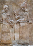 Ancient Babylonia and Assyria bas relief. Ancient Babylonia and Assyria sculpture painting from Mesopotamia Royalty Free Stock Photos