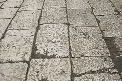 Ancient background of the Roman pavement Royalty Free Stock Images