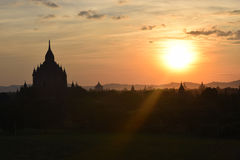 Ancient Bagan temples at sunset, Mandalay, Myanmar. Some of the thousands of temples that are spread across the plains of Bagan. One of the richest Royalty Free Stock Photo