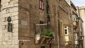 Ancient balconies in the ancient city of Valletta, Malta. Valletta - Italian word for Small valley is the capital city of Malta Royalty Free Stock Images