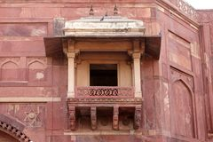 Ancient balcony inside Jodha Bai Palace in Fatehpur Sikri complex. Fatehpur Sikri, India, built by the great Mughal emperor, Akbar stock photo