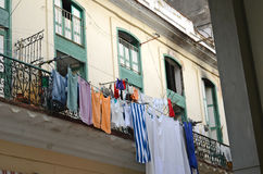 Ancient balcony on the street with drying sheets Royalty Free Stock Image