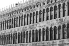 Ancient balcony in Venetian style with arched windows in saint m Stock Images