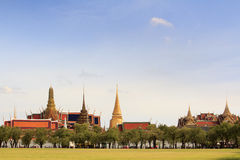 Ancient bangkok thailand grand palace. And temple in bright blue sky Royalty Free Stock Image