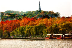 Ancient Baochu Pagoda Boats West Lake Hangzhou Zhejiang China. Pagoda was constructed in 963AD stock image