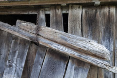 Ancient barn door and rusty chain stock image