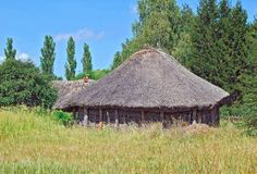 Ancient barn with a straw roof. Ancient traditional ukrainian rural barn with a straw roof Stock Photos