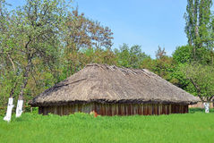 Ancient barn with a straw roof Royalty Free Stock Photos