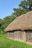Ancient barn with a straw roof Royalty Free Stock Photo