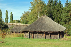 Ancient barn with a straw roof Stock Images