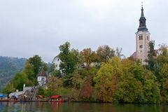 Ancient baroque church among autumn foliage on Bled Island in Slovenia Royalty Free Stock Photography