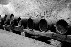 ANCIENT BARRELS. IN A DUSTY CELLAR OF AN OLD CASTLE SOME BARRELS RETAIN THE WINE Stock Image