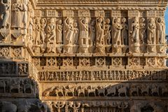 Ancient bas-relief with Apsaras at famous ancient Jagdish Temple in Udaipur, Rajasthan, India. It has been in continuous worship since 1651 stock images