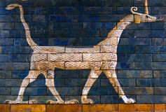 Ancient bas-relief at the Babylonian Ischtar Tor. Ancient glazed brick panel with Sirrush - details of the Babylonian Ischtar Tor (Ishtar Gate) in the Istanbul royalty free stock photos