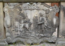 Ancient bas-relief The boy and a dog in Gdansk, Poland Royalty Free Stock Image
