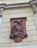 Ancient bas relief on building wall in Ljubljana, Slovenia Stock Photos
