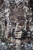 Ancient bas-relief in Cambodia. Face Towers in the ancient city of Cambodia Royalty Free Stock Photos
