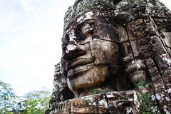 Ancient bas-relief in Cambodia. Face Towers in the ancient city of Cambodia Stock Images