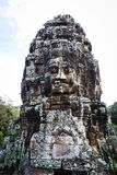 Ancient bas-relief in Cambodia. Face Towers in the ancient city of Cambodia Royalty Free Stock Image