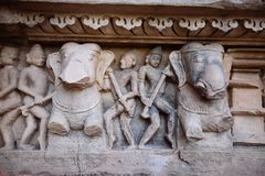 Ancient bas-relief at famous erotic temple in Khajuraho, India. Stock Image