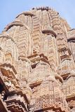 Ancient bas-relief at famous erotic temple in Khajuraho, India. Unesco World Heritage Site royalty free stock photography