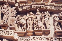 Ancient bas-relief at famous erotic temple in Khajuraho, India. Unesco World Heritage Site royalty free stock images