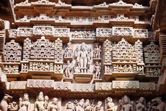 Ancient bas-relief at famous erotic temple in Khajuraho, India. Unesco World Heritage Site royalty free stock image