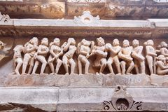 Ancient bas-relief at famous erotic temple in Khajuraho, India. Unesco World Heritage Site royalty free stock photos
