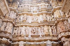 Ancient bas-relief at famous erotic temple in Khajuraho, India. Unesco World Heritage Site stock photography