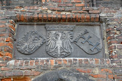 Ancient bas-relief with the image of the coats of arms of the We Royalty Free Stock Images