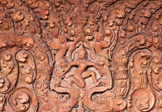 Ancient bas-relief at the temple in Angkor Wat, Cambodia. Stock Photos