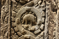 Ancient Bas Relief with Vine Pattern and Mysterious Symbols Stock Photo