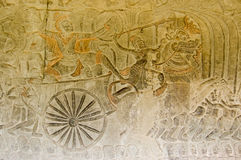 Ancient Bas Relief of Vishnu conquering the demons Stock Image