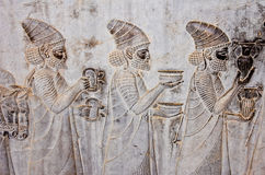 Ancient bas-reliefs of Persepolis. Bas-relief carvings in ancient city of Persepolis,Shiraz Royalty Free Stock Photography