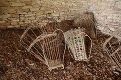 Ancient baskets  ( Alpine Gerla ) on the floor of a hut. Royalty Free Stock Photo