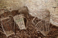 Ancient baskets  ( Alpine Gerla ) on the floor of a hut. Stock Image